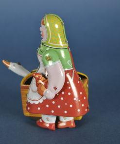 Speelgoed mechanisch blik vrouw met ganzen