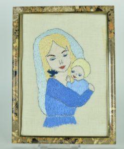 Borduurwerk van een vrouw met kind